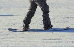 Parte dos esquiadores na neve Fotografia de Stock Royalty Free
