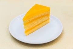 Parte fresca de bolo de creme alaranjado Imagem de Stock