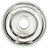 Parte inferiore di una bottiglia di vetro su una priorità bassa bianca Immagini Stock