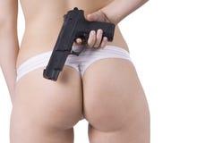 Parte inferiore e pistola posteriori della donna in biancheria Fotografie Stock Libere da Diritti