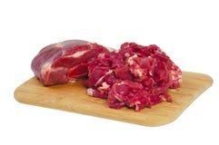 A parte inteira e a carne de carneiro cortada Foto de Stock Royalty Free