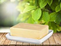 Parte leitosa da manteiga da leiteria na tabela de madeira Fotos de Stock Royalty Free