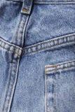 Parte posterior de los tejanos del dril de algodón Foto de archivo libre de regalías