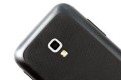 Parte posteriore dello Smart Phone con la camera su un backgro bianco Fotografie Stock Libere da Diritti