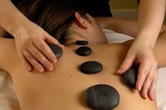 Parte posteriore minerale calda della pietra di massaggio Fotografie Stock Libere da Diritti