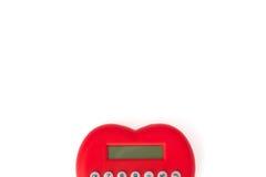 Calculadora vermelha dada forma como um coração Foto de Stock Royalty Free