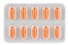 A parte superior da vista de comprimidos alaranjados embalou na bolha foto de stock