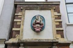 Parte superiore di decorazione di arte della casa antica a Haarlem Fotografia Stock
