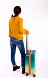 Parte traseira da menina com mala de viagem fotos de stock royalty free