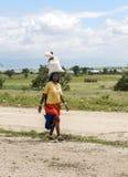 Parte traseira da mulher com sacos Imagem de Stock