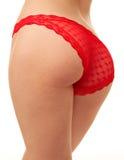 Parte traseira da mulher na cuecas vermelha Imagens de Stock