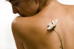 Parte traseira de Woman´s com flor branca Imagens de Stock
