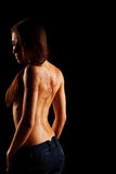 Parte traseira despida da moça com o mehendi da tatuagem da hena Imagem de Stock