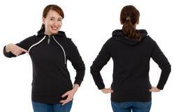 Parte traseira dianteira e opinião preta traseira da camiseta Apontar e mostra da mulher na roupa do molde para o espaço da cópia imagens de stock