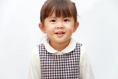 Parte traseira japonesa de sorriso do branco da menina Foto de Stock