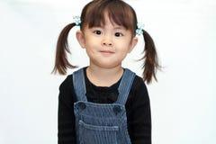 Parte traseira japonesa de sorriso do branco da menina Imagens de Stock Royalty Free