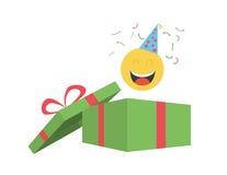 Partei Emoticon, der aus Geschenkbox herauskommt Stockfoto