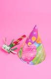 Partei-Hut auf rosa Hintergrund stockbild