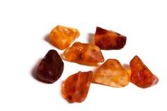 Partes ambarinas isoladas no branco Fotos de Stock Royalty Free