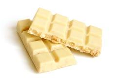 Partes brancas do chocolate com porcas Fotografia de Stock Royalty Free