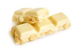 Partes brancas do chocolate com porcas Imagem de Stock