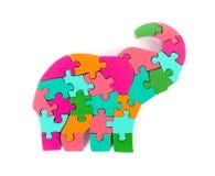 Partes coloridas do enigma na forma do elefante Imagem de Stock