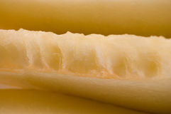 Partes cortadas de fundo do amarelo da textura do melão Imagens de Stock Royalty Free