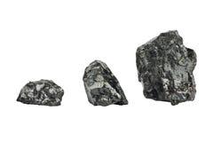 Partes de carvão no fundo branco isolado Imagem de Stock