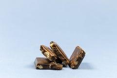 Partes de chocolate com porcas Fotografia de Stock Royalty Free