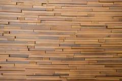 Partes de madeira pequenas junto em uma parede Imagem de Stock