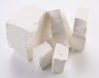 Partes de queijo de feta. fotografia de stock