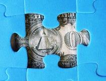 Partes de um dólar e de enigma Imagem de Stock Royalty Free