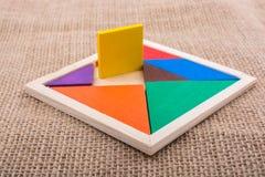 Partes de um enigma quadrado do tangram Fotografia de Stock Royalty Free