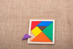 Partes de um enigma quadrado do tangram Fotos de Stock