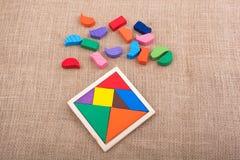 Partes de um enigma quadrado do tangram Fotografia de Stock