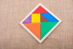 Partes de um enigma quadrado do tangram Fotos de Stock Royalty Free