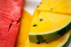 Partes de uma melancia colorida suculenta Imagens de Stock