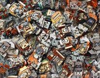 Partes de unidades óticas velhas como o fundo do desperdício industrial imagem de stock