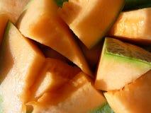 Partes del melón anaranjado Imagen de archivo libre de regalías