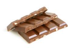 Partes do chocolate com porcas Fotos de Stock Royalty Free