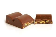 Partes do chocolate com porcas Fotografia de Stock