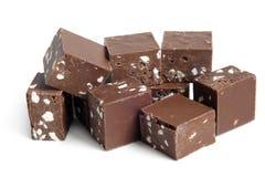 Partes do chocolate com porcas Imagens de Stock