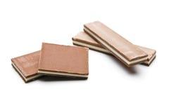 Partes do chocolate em um fundo branco Imagens de Stock