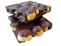 Partes do chocolate no fundo branco Imagens de Stock