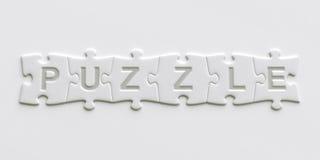 Partes do enigma com o texto escrito neles Foto de Stock