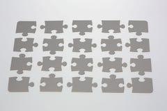 Partes cinzentas do enigma de serra de vaivém Fotografia de Stock Royalty Free