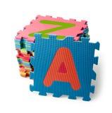 Partes do enigma do alfabeto no fundo Imagens de Stock