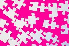 Partes do enigma na cor-de-rosa Foto de Stock