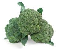 3 partes dos brócolis isolados na fotografia branca do alimento do fundo Foto de Stock