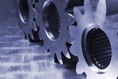 Partes mecânicas no azul Imagens de Stock